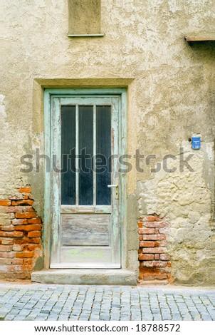 A shot of a grunge house facade - stock photo