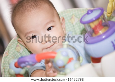 A shot of a happy asian baby boy - stock photo
