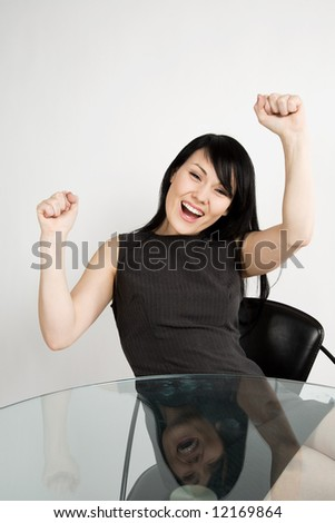 A shot of a happy beautiful businesswoman at her office - stock photo