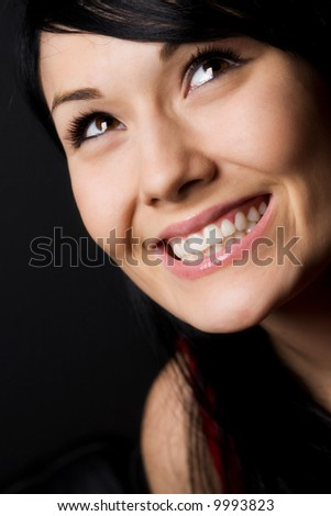 A shot of a happy beautiful young woman - stock photo