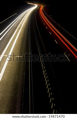 A shot of a highway at night - stock photo