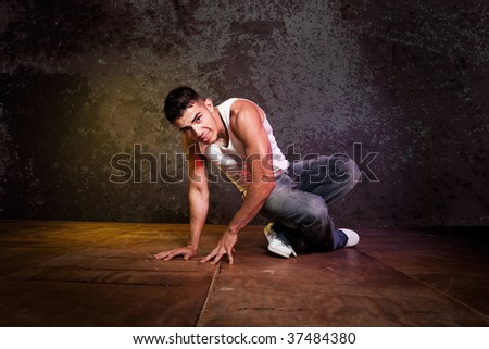A shot of a hispanic male doing a hip-hop dance - stock photo