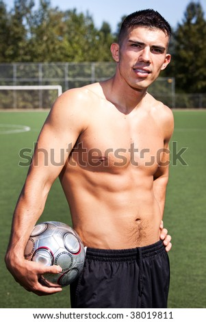 A shot of a hispanic soccer or football player - stock photo