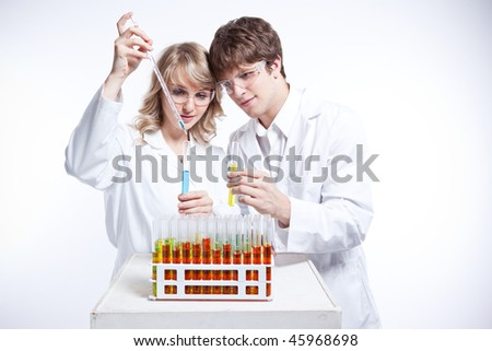 A shot of a male and female caucasian scientists - stock photo