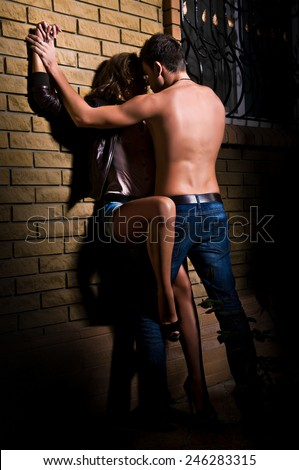 A shot of a man and a woman in love kissing - stock photo
