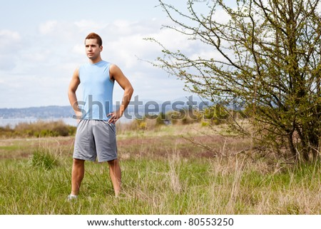 A shot of a mixed race man getting ready to exercise outside - stock photo