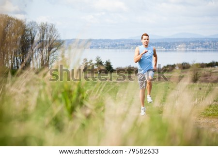 A shot of a mixed race man running outdoor - stock photo