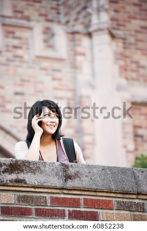 A shot of a mixed race student talking on the phone