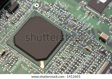 A shot of a new computer mother board.  This image is a nice background image for print material related to computer technology. - stock photo