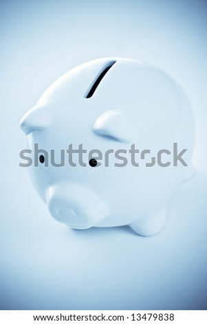 A shot of a piggy bank in blue tone