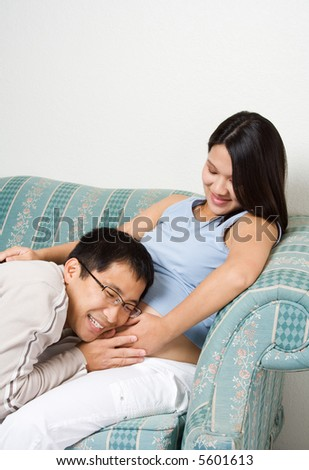 A shot of a pregnant woman and her husband, can be used as parenting or pregnancy concept