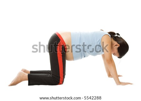 A shot of a pregnant woman exercising - stock photo