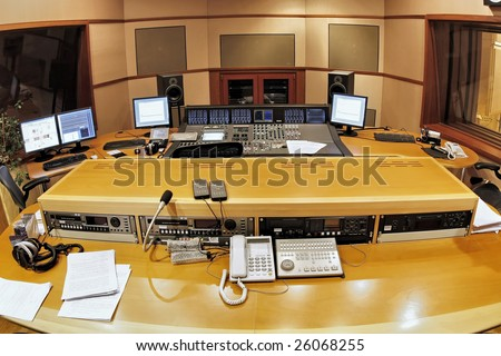 A shot of a professional recording studio, complete with technical equipment. - stock photo