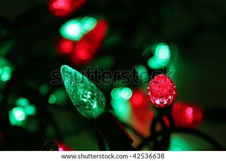 A shot of a red and green Christmas light string. - stock photo