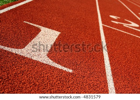 A shot of a running track on an athletic field - stock photo