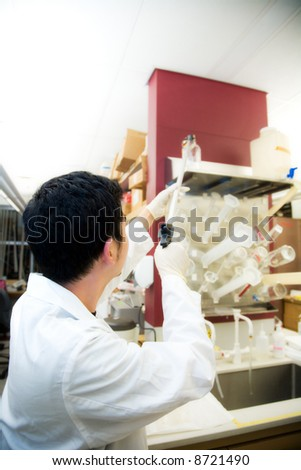 A shot of a scientist working at a laboratory - stock photo