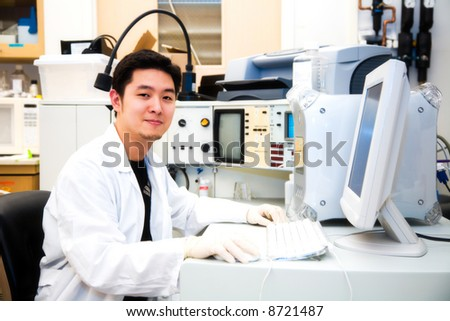 A shot of a scientist working on a computer in a laboratory - stock photo