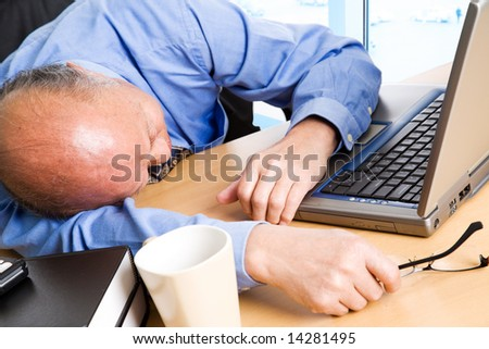 A shot of a senior asian businessman taking a nap in the office - stock photo