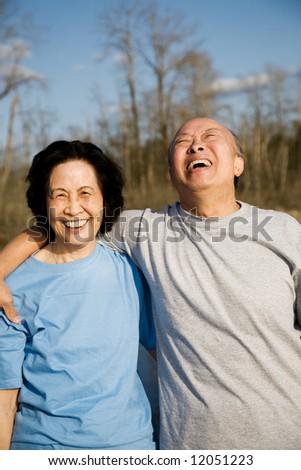 A shot of a senior couple having a good time outdoor - stock photo