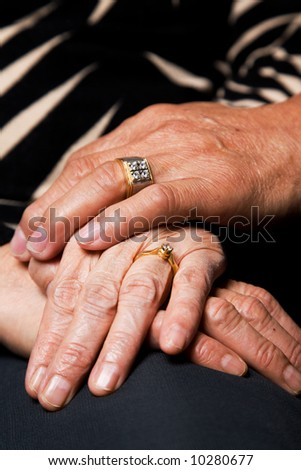 A shot of a senior couple holding hands