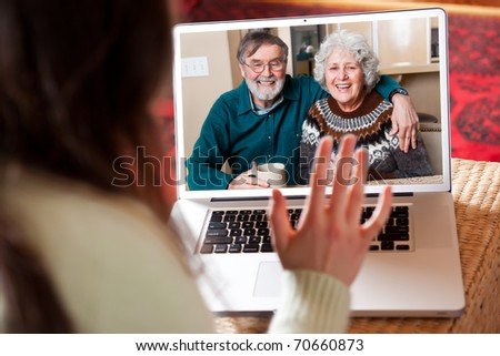 A shot of a senior couple video conferencing with their granddaughter - stock photo