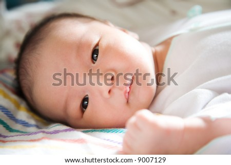 A shot of a sleeping cute baby boy - stock photo