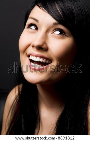 A shot of a smiling and happy beautiful woman - stock photo