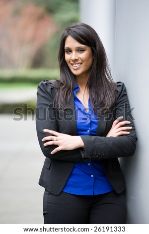 A shot of a smiling asian indian businesswoman outdoor - stock photo