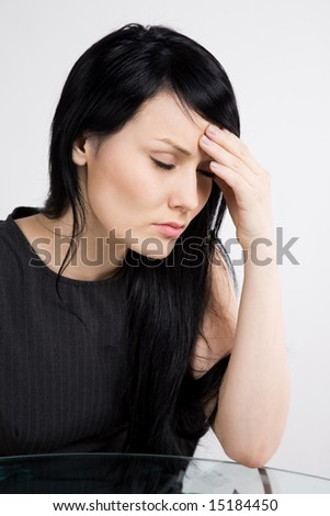 A shot of a stressed and ill businesswoman - stock photo