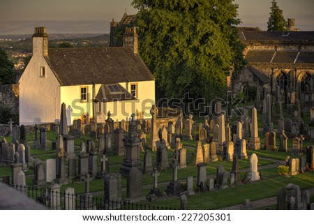 A shot of a Sunset on graveyard house - stock photo