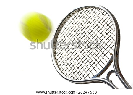 A shot of a tennis racket hitting a tennis ball.(with motion blur on the ball) - stock photo