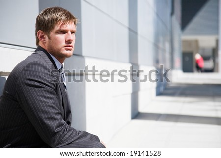 A shot of a thinking confident caucasian businessman