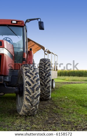 A shot of a truck used for harvesting on a corn field - stock photo