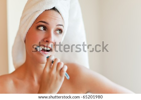 A shot of a young beautiful woman brushing her teeth - stock photo