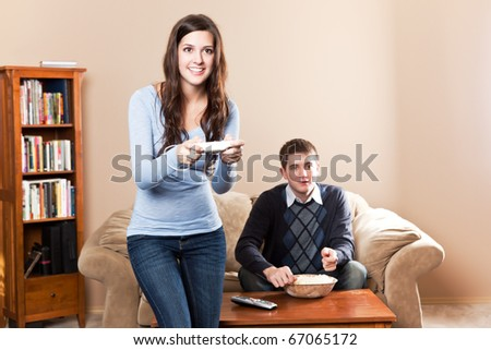 A shot of a young couple playing video games