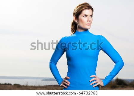 A shot of an active beautiful caucasian woman outdoor in a park - stock photo