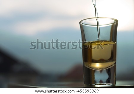 A shot of an alcohol beverage  - stock photo