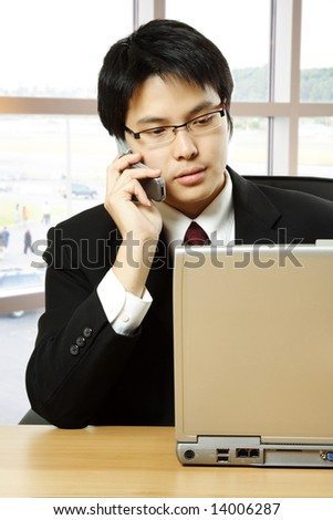 A shot of an asian businessman working in the office - stock photo