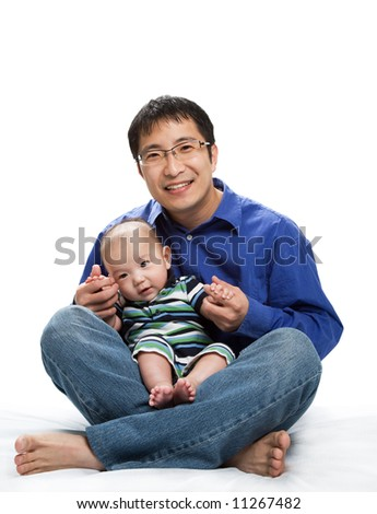 A shot of an asian father and his son - stock photo