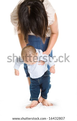 A shot of an asian mother teaching her son how to walk