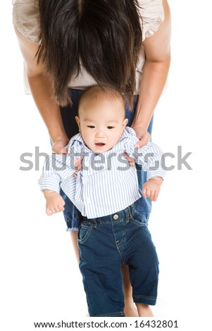 A shot of an asian mother with her cute baby son - stock photo