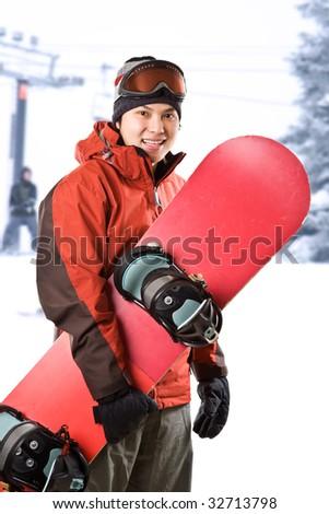 A shot of an asian snowboarder at a ski resort - stock photo