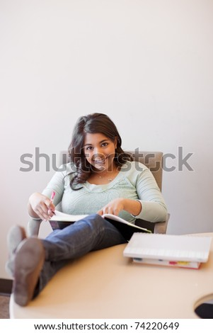 A shot of an asian student studying in a library