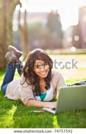 A shot of an asian student using laptop on campus - stock photo
