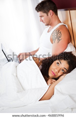 A shot of an interracial couple having a relationship conflict - stock photo