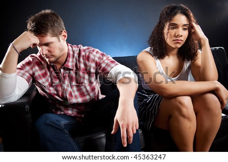 A shot of an interracial couple having a relationship problem - stock photo
