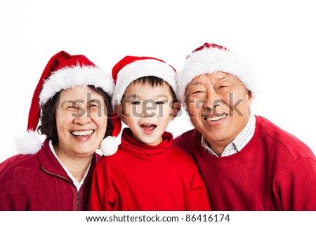 A shot of Asian grandparents celebrating Christmas with their grandson - stock photo