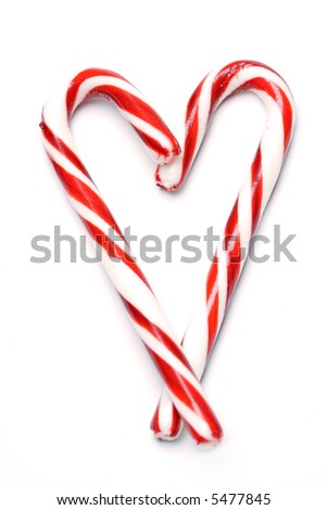 A shot of christmas candy cane in a heart shape