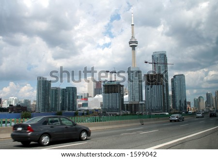 A shot of downtown Toronto from the Gardiner expressway. - stock photo