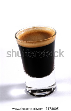 a shot of espresso on classy shot glass - stock photo